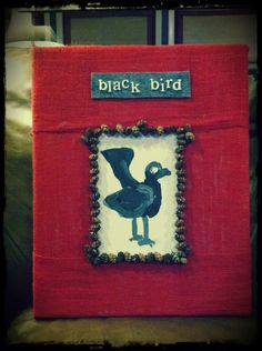 natural inspiration. black bird.  red burlap. pinecones.