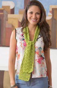 This Dainty Shells Scarf is the perfect lacy scarf to wear any time of the year. The brightly colored yarn used for this free crochet scarf pattern will add the perfect splash of color to your outfit. Use Red Heart Luster Sheen yarn to make this stylish accessory. The pretty lime green color shown here is great to wear during the spring and summer months. It's dainty like seashells, and it's lightweight enough to wear to the beach.