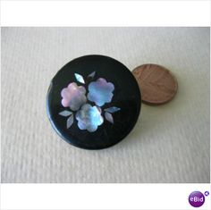 Victorian papier mache button inlaid with mother of pearl floral detail on eBid United Kingdom