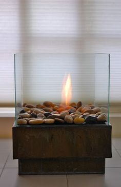 glass firepot- make your own  http://www.theartofdoingstuff.com/how-to-make-a-personal-fire-pit-for-cheap (english instrustions)