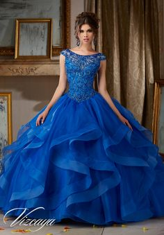 Organza Quinceañera Dress with Jeweled Beaded Bodice and Bateau Neckline. Open Keyhole Corset Back. Matching Stole. Colors Available: Red, Royal, White