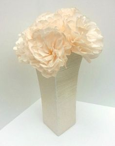 This listing is for individual Ivory Peony Roses. These flowers are perfect for weddings, bridal showers, baby showers or any other soiree! They're also beautiful as table centerpieces or bridesmaid bouquets. These blooms will match any decor and always brighten up any space.  Each flowers comes standard on a moss green chenille stem. Flowers are approximately 12 tall with blooms about 4 wide. The bloom size can vary slightly due to the nature of this item…