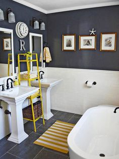 Colorful Organizer: Small bathrooms call for creative storage solutions. In this bathroom, a painted etagere placed between a pair of pedestal sinks provides plenty of storage and display space in a small footprint. The striking yellow hue also lends a dose of personality to the neutral space.