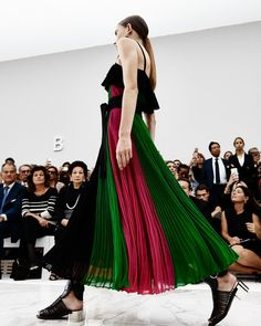 Flowing dresses with pleats in many different colors accentuated movement as they came down the runway. (Photo: Molly S.J. Lowe)