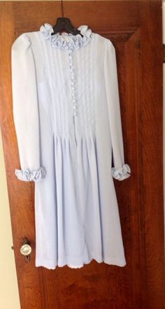 A personal favorite from my Etsy shop https://www.etsy.com/listing/293434395/gorgeous-powder-blue-vintage-dress-with