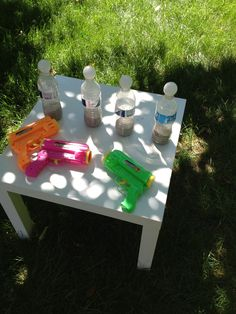 ping bong balls & water bottles filled with sand .. buy toy shooters from the dollar store to complete the game! #DIY #kids #carnival #fun