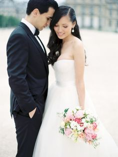Paris wedding pics. The bride is wearing a customized wedding gown. Pretty bouquet of peonies, roses, and jasmine.
