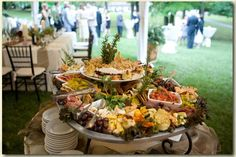 Happy Hour - hors d'oeuvres setup idea. All foods are raised and app plates and napkins tuck in under a bit. Like it.