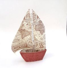 a beautiful boat made from book cover & book pages.