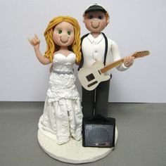 Rock n Roll wedding cake topper. Handmade using polymer clay by clayinaround.etsy.com