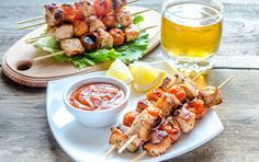 Grilled chicken skewers with cherry by delibreeder foods on Creative Market