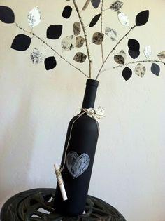 Up-Cycled Chalkboard Wine Bottle - Eco-Friendly Centerpiece - Wedding - Paper Leaves - Custom. $10.00, via Etsy.