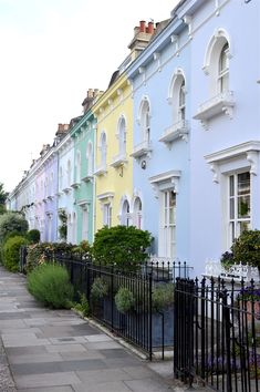 Hammersmith and Fulham, Wingate Road Wingate Road might be straight out a fairytale. With its pastel houses and its pretty balconies, the cuteness here is overwhelming. Beautiful London, Most Beautiful Cities, Beautiful Buildings, London Places, London Hotels, London Tourist Spots, London Eye, Places To Travel, Places To See