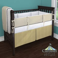 Crib bedding in Solid Antique White, Taupe Ticking, Natural Organic, White Pimatex, Solid Gold Satin. Created using the Nursery Designer® by Carousel Designs where you mix and match from hundreds of fabrics to create your own unique baby bedding. #carouseldesigns