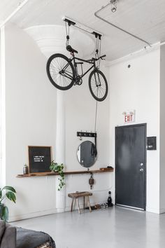 Nautical Scandinavian Style in a Bright White Toronto Loft This Toronto apartment's super high ceilings work perfectly for this one-of-a-king bike pulley sy Toronto Lofts, Toronto Apartment, Indoor Bike Storage, Bicycle Storage, Hanging Storage, Bike Storage Ideas Ceiling, Bike Storage Pulley System, Bike Storage Small Space, Vertical Storage