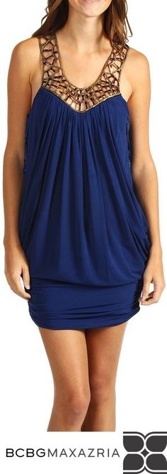 """BCBGMAXAZRIA'S """"Embellished Jersey Cocktail Dress"""" in Gold/Navy, retails at $248. Add some class with a touch of sass to your wardrobe with this embellished dress! Scoop neck is accentuated with a unique design/sequins all around the collar. Slip-on construction for convenient on and off. Ruched design. Fitted waist allows for eye-catching contrast."""