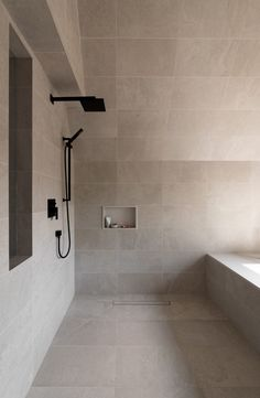 The woodwork leads towards the en-suite bathroom at the front of the house, whose walls and pitched ceiling is is covered in grey concrete.