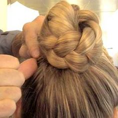 Pulling it above its base, wrap the braid around itself, securing the edges to the head with bobby pins. Flatten any flyaways with hair pomade and finish with hairspray. Hair How-To: Braided Crown Hairstyle