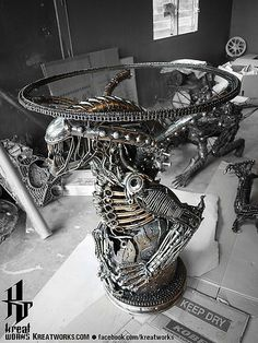 Dieselpunk recycled metal statues by Kreatworks - Alien Table