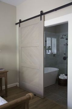 Master bathroom remodel, barn door, shower, free standing bath tub gives a modern look with rustic touch Modern Bathroom, Small Bathroom, Master Bathroom, Master Closet, Master Bedrooms, Master Tub, Master Baths, Gray Bedroom, Master Suite