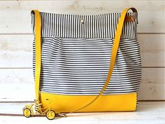 Items similar to BEST SELLER Diaper bag / Messenger bag STOCKHOLM Gray geometric nautical striped Leather / 10 pockets Featured on The Martha Stewart on Etsy Best Diaper Bag, Baby Diaper Bags, Little Man Style, Yellow Leather, Waterproof Fabric, Handmade Bags, Bag Making, Messenger Bag, Purses And Bags