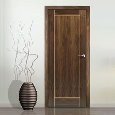 Jb kind Vina walnut veneer flush fire door with oak inlay groove is pre-finished and 1/2 hour fire rated for added safety in the home. #firedoor #walnutdoor
