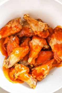 Easy Air Fryer Chicken Wings are so crispy and delicious without using any extra oil! Cooking Chicken Wings in an Air Fryer insteadof deep-frying or baking them in the oven makes them healthier, simpler and clean up easier. They're ready in only 30 minutes and you only need 2 ingredients! Toss them with buffalo sauce or your favorite BBQ sauce for an easy appetizer that's perfect for your game day party! #AirFryerRecipes #appetizer #wings #buffalowings #hotwings #gameday