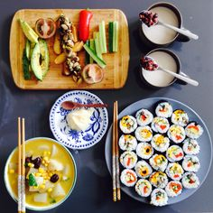 Sushi with carrot soup  Red bean soup  vegetable salad