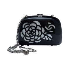 Chanel Black Resin Camellia Clutch As Seen On Claudia Schiffer | From a collection of rare vintage handbags and purses at http://www.1stdibs.com/fashion/accessories/handbags-purses/