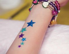Glitter tattoos are another modern arts that are chosen for parties especially. They can be best inscribed on kids. Here are top picks that will really wonder you Glitter Tattoos, Glitter Henna, Glitter Tattoo Stencils, Body Glitter, Star Tattoos, Body Art Tattoos, Tattoo Ink, Glitter Paint For Walls, Glitter Gel Polish