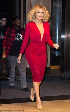 Strutting her stuff: Khloe Kardashian rocked her hottest outfit to date and some voluminous curls in New York on Friday as she headed to an appearance on hit chat show Live! with Kelly and Michael