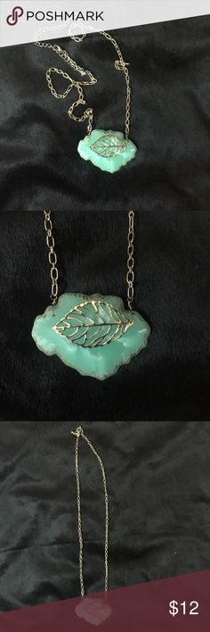 Long Necklace Such a cute necklace! It's long and ends with a teal stone. There's a gold leaf on the stone. Even though I only wore it once, there's just a slight discoloration where the clamp is. Jewelry Necklaces
