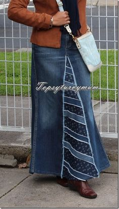 I love this jean skirt because it looks like it belongs. They match colors, they did not open up the crotch and sew it on itself, and they used trim to make a great transition from one fabric to another. Too bad the topsyturvymum site is private. . .