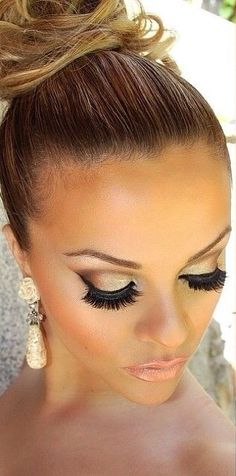 Bronze smokey eye with well defined wings.