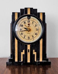 This clock features a bold typeface, and use of line and angles. The levelled structure shows vertical emohasis and height, and the angled use of line is interesting and eye-catching, and also forms a zig-zagged shape. Minimal colours have been used, and they brighten and contrast eachother.
