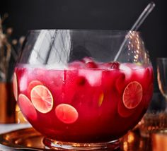 Get the party started with this refreshing punch. Making fruit ice cubes stops the cranberries from sinking to the bottom of the glass – clever!