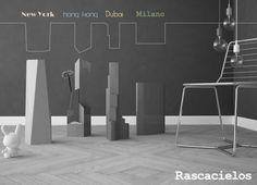 """Formabilio - Rascacielos sono un gruppo di quattro vasi in lamiera d'acciaio tagliata a laser che prendono ispirazione da quattro grattacieli che caratterizzano lo skyline di quattro città del mondo (Milano/New York/Hong Kong/Dubai).I vasi sono spruzzati a polvere in quattro colorazioni diverse.Abbiamo pensato anche ad una gamma con finiture più """"nobili"""" (e pertanto più costose) utilizzando acciaio cromato,ramato,nichelato e spazzolato."""