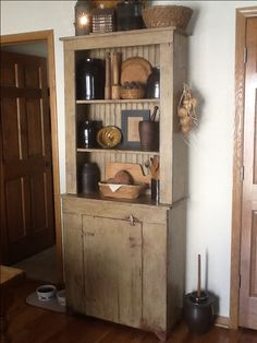 My hubby and I made this hutch from a plan from The Wooden Nail. He did the building and I did the finishing. I used Benjamin Moore Tyler Taupe over Olde Century Barn Red, then finished with Bri-wax Dark Wood wax.