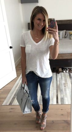 The perfect white tee with distressed jeans and lace up sandals! Daily uniform! Click on the photo for all of the links to shop!