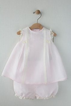 A sweet dress for the wedding of her parents