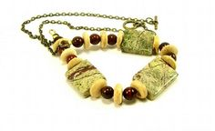 Rainforest marble and Brecciated jasper accent each other beautifully for this gemstone jewelry necklace. All the stones are natural. To define the stones I used coconut palm wood roundels in-between each stone bead... To keep the rustic feel antique gold steel small link chain, with a toggle clasp to close...Jungle Chic, Statement Necklace....Made and Ready to ship...* Colors are a mix of Greens, Tan, Red Browns, with a beautiful pattern.   * Total length including toggle clasp is 19 ...