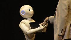 Softbank CEO and 'caring' robot Pepper, jointly developed with Aldebaran.