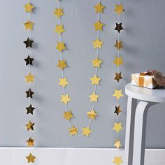 metallic star paper garland by funky frills uk | notonthehighstreet.com