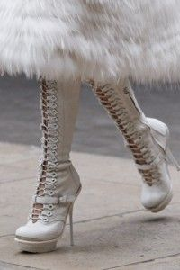 Alexander McQueen Fierce White Boots.  I love the skirt and the high heeled boots!!!