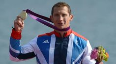Great Britain's Ed Mckeever poses on the podium with his gold medal won in the kayak single (K1) 200m men's final at the London Olympics (AFP)
