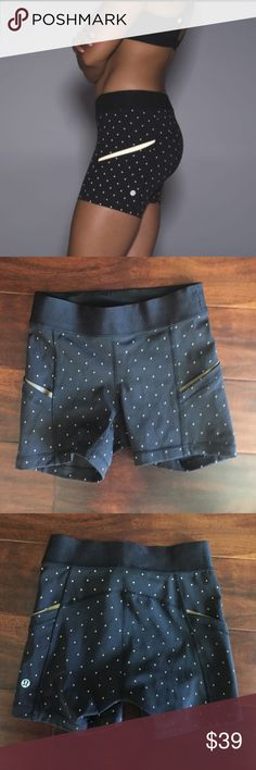 Reflective! Lululemon shorts with reflective dots Super cute lululemon shorts with reflective dots. 2 side pockets with reflective gold stripes. Worn 5x,  originally retail for $98+tax.  Size 2 No trades. lululemon athletica Shorts