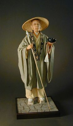 Japanese Monk  One of a kind Art Doll Setting...sculpted in Quality Polymer Clay and hand painted.  All fabrics hand dyed, shoes carved in wood, Hat is hand woven.