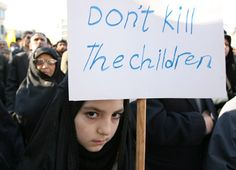 Iranian people hold a demonstration in Tehran, capital of Iran, on Jan. 2, 2009, to protest against Israel's continued air strikes on the Gaza Strip.