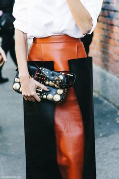 Street style // leather skirt + panels // chic fashion // clutch