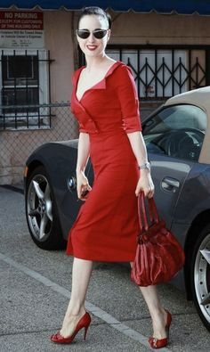 Dita - love the RED, the length, the jacket, the shoes....